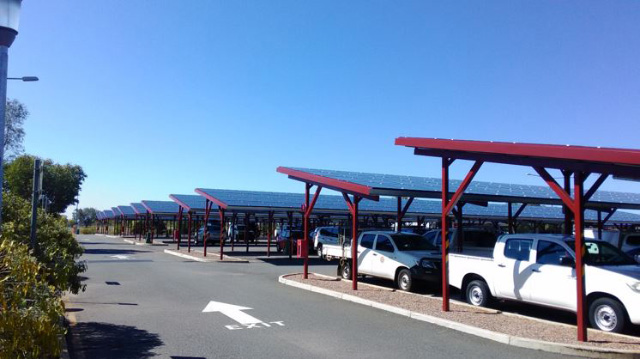 Example of a solar car port bringing value to an otherwise underutilised area. (Alice Springs airport)