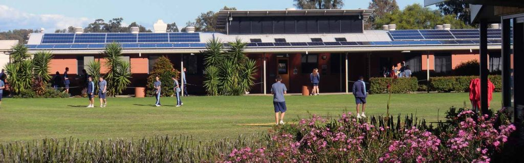 A larger array of solar panels on the Science Block overlooks the oval at Thornlie Christian College